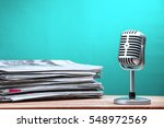 retro microphone with newspaper ... | Shutterstock . vector #548972569