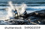 Surfing In Norway During Winte...