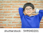 Portrait Of Asian Boy Wearing...