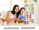 teacher and kid girl learn mold ...   Shutterstock . vector #549053599