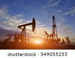 oil pump on orange sunset | Shutterstock . vector #549055255