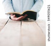 bible in hands of a woman. she... | Shutterstock . vector #549055621