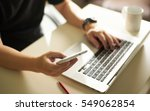 young sman hand using smart...   Shutterstock . vector #549062854