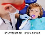 dentist in dental fillings to... | Shutterstock . vector #549155485