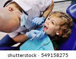 male dentist examines the teeth ... | Shutterstock . vector #549158275