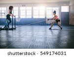 fitness sled pull with female... | Shutterstock . vector #549174031