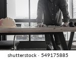 engineers with a desk in the... | Shutterstock . vector #549175885