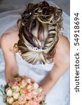 A caucasian bride photographed from above to show off her hair - stock photo