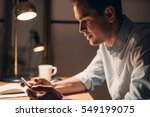 young businessman working on a... | Shutterstock . vector #549199075