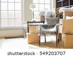 moving boxes and furniture in... | Shutterstock . vector #549203707