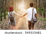 Couple In Hold Hands In The...