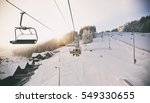 people are lifting on ski lift... | Shutterstock . vector #549330655