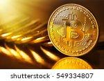 golden bitcoins on a gold... | Shutterstock . vector #549334807