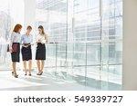 full length of businesswomen... | Shutterstock . vector #549339727