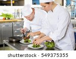 two chefs prepares steak dish... | Shutterstock . vector #549375355