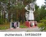 Small photo of Belarus, Bobruisk district, the village of Kamenka, September 15, 2015: Monument to the Heroes indemnify and defend their homeland. Sculpture of two soldiers with arms and flag