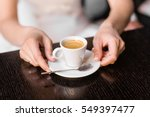 woman holding hot cup of coffee | Shutterstock . vector #549397477