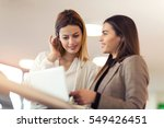 two business women talking at... | Shutterstock . vector #549426451