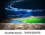 wooden table against football... | Shutterstock . vector #549430459