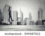 businessman with blindfolder on ... | Shutterstock . vector #549487021