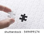 white jigsaw puzzle | Shutterstock . vector #549499174