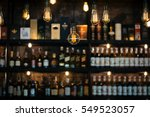 Stock photo blurred picture of vintage lamps with liquor bar 549523057