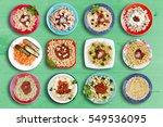 multiple pasta dishes on green... | Shutterstock . vector #549536095