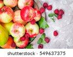 fresh raspberries and apples on ... | Shutterstock . vector #549637375