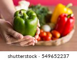 Green Peppers In Woman Hand...