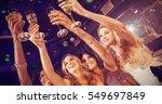 pretty girls holding champagne... | Shutterstock . vector #549697849