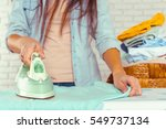 closeup of woman ironing... | Shutterstock . vector #549737134