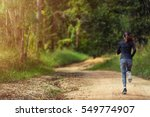 young woman running on a trail... | Shutterstock . vector #549774907