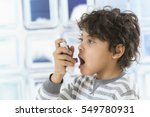 boy using  nasal spray bottle.  ... | Shutterstock . vector #549780931