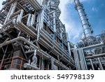 Small photo of Close up Industrial view at oil refinery plant form industry zone with sunrise and cloudy sky