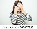 woman closes eyes with her hands | Shutterstock . vector #549807235