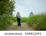 brunette woman hiker hiking on... | Shutterstock . vector #549812491