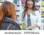 pharmacist talking with a... | Shutterstock . vector #549938161