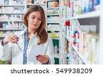 woman pharmacist holding... | Shutterstock . vector #549938209