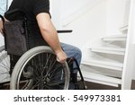 Small photo of Empty wheelchair and stairs. Disabled accessibility reality