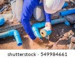 construction worker repairing a ... | Shutterstock . vector #549984661