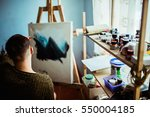 male artist working on painting ... | Shutterstock . vector #550004185