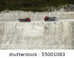 Small photo of going dumper trucks in after the hillside in a chalk pit