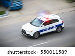 Police Car In Motion Blur With...