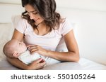 Young Mother With Baby In Bed