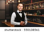 young handsome waiter with... | Shutterstock . vector #550138561