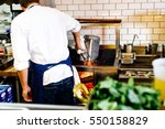chef makes sparks fly over... | Shutterstock . vector #550158829