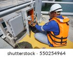 a technician doing maintenance... | Shutterstock . vector #550254964