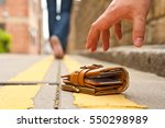 guy picking up a lost a lost... | Shutterstock . vector #550298989