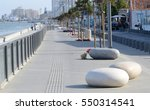 View of Larnaca seafront with palm trees and stone shaped benches.Larnaca -  is a city on southern coast of Cyprus island.