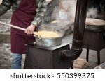 man is making polenta  the... | Shutterstock . vector #550399375